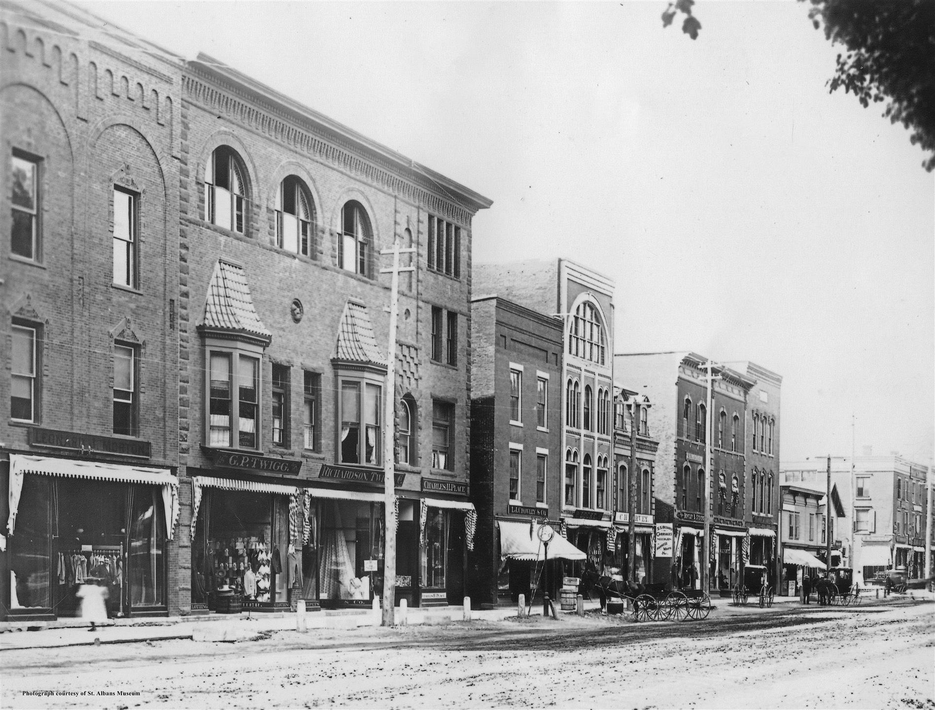 an old black and white picture of the clothier storefront