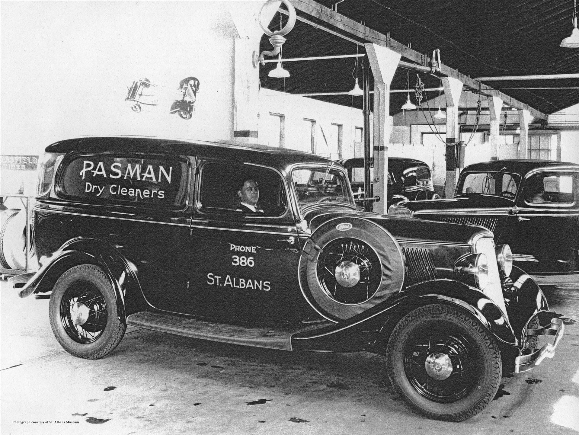 "an old car, labelled, ""Pasman Dry Cleaners"""