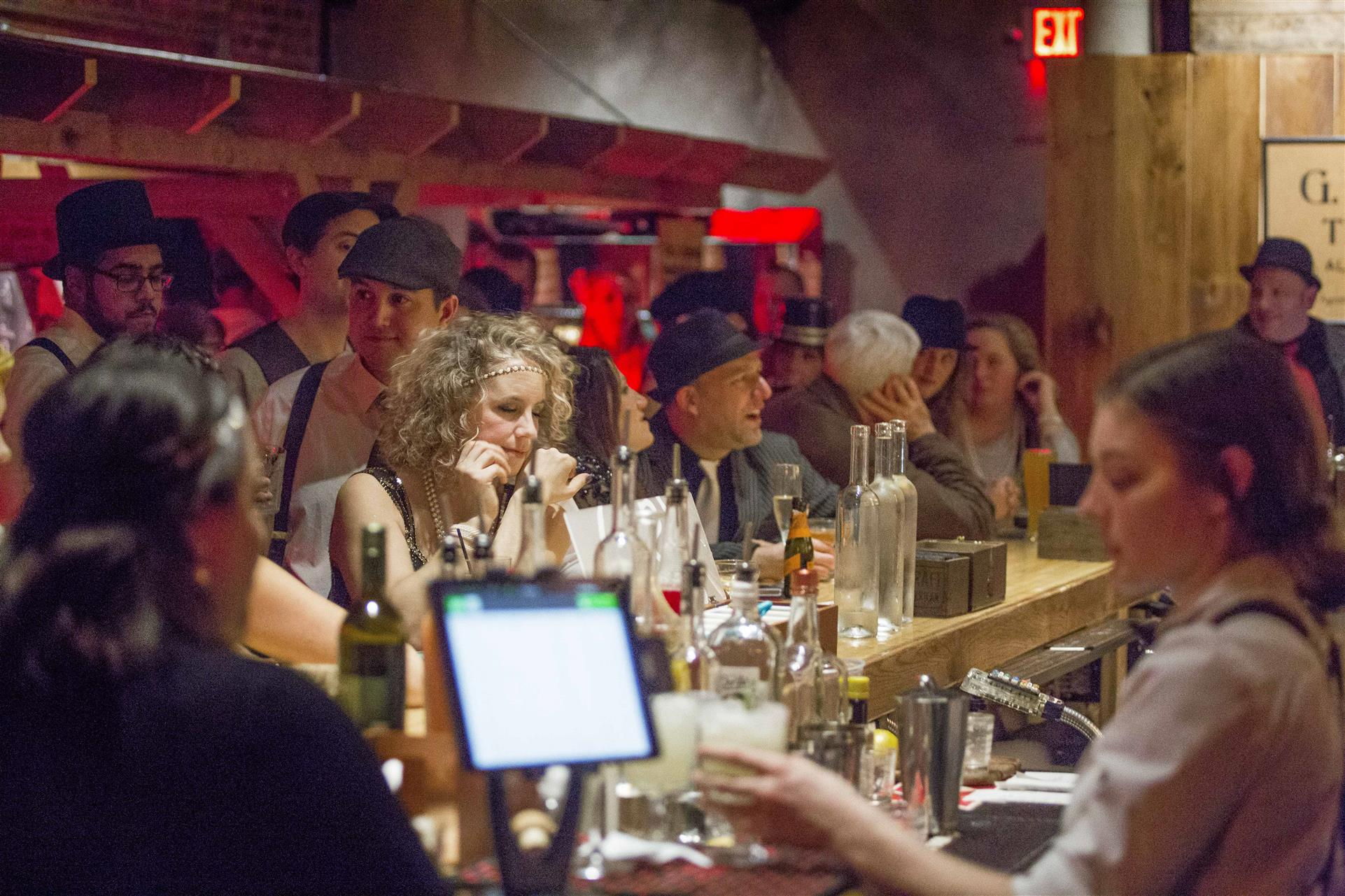 bar shot of ladies and men dressed in 1920s clothing