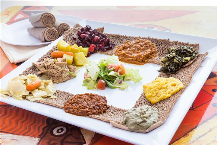 Vegetarian choices in a platter, served with humus fit fit, salad, beets, and azifa