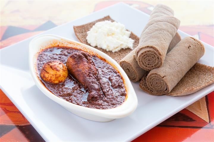 A drumstick or thigh slow cooked stew with berbere, onion, garlic and Kibe spiced butte, served with injera and cottage cheese