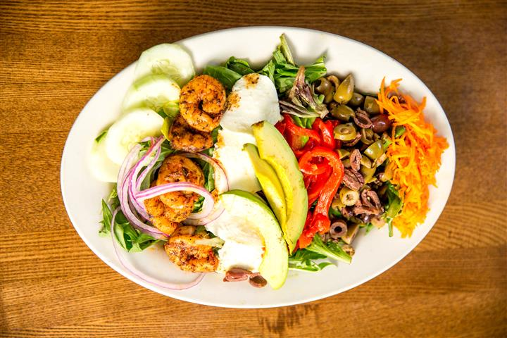 Shrimp, Avacados, Cheese, and other vegetables on a platter