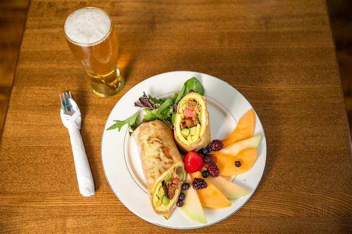 Wrap with slices of fruit to the side