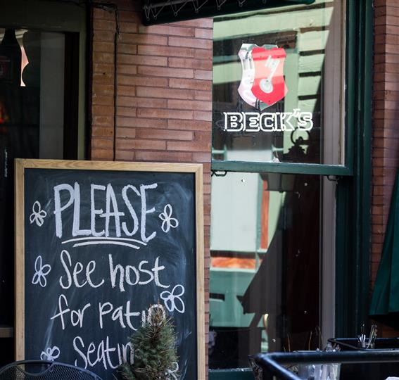 """Sign that says """"Please see host for patio seating"""""""