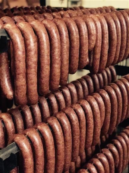 Dozens of sausages on racks