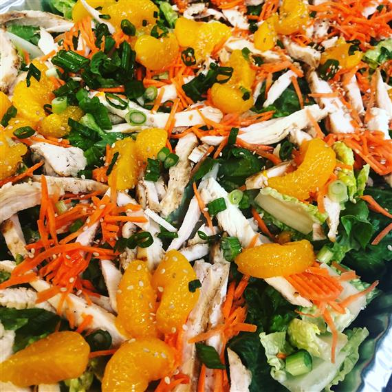 salad with cabbage, shredded carrots, tangerines, scallions, and shredded chicken