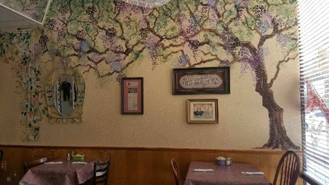 Interior of Restaurant showing wall decor of trees