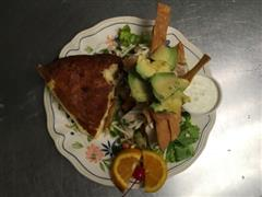 Half sandwich plate with side salad