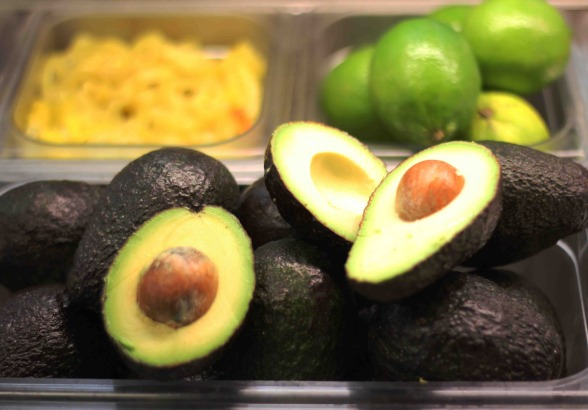 Avocados and limes in food prep containers