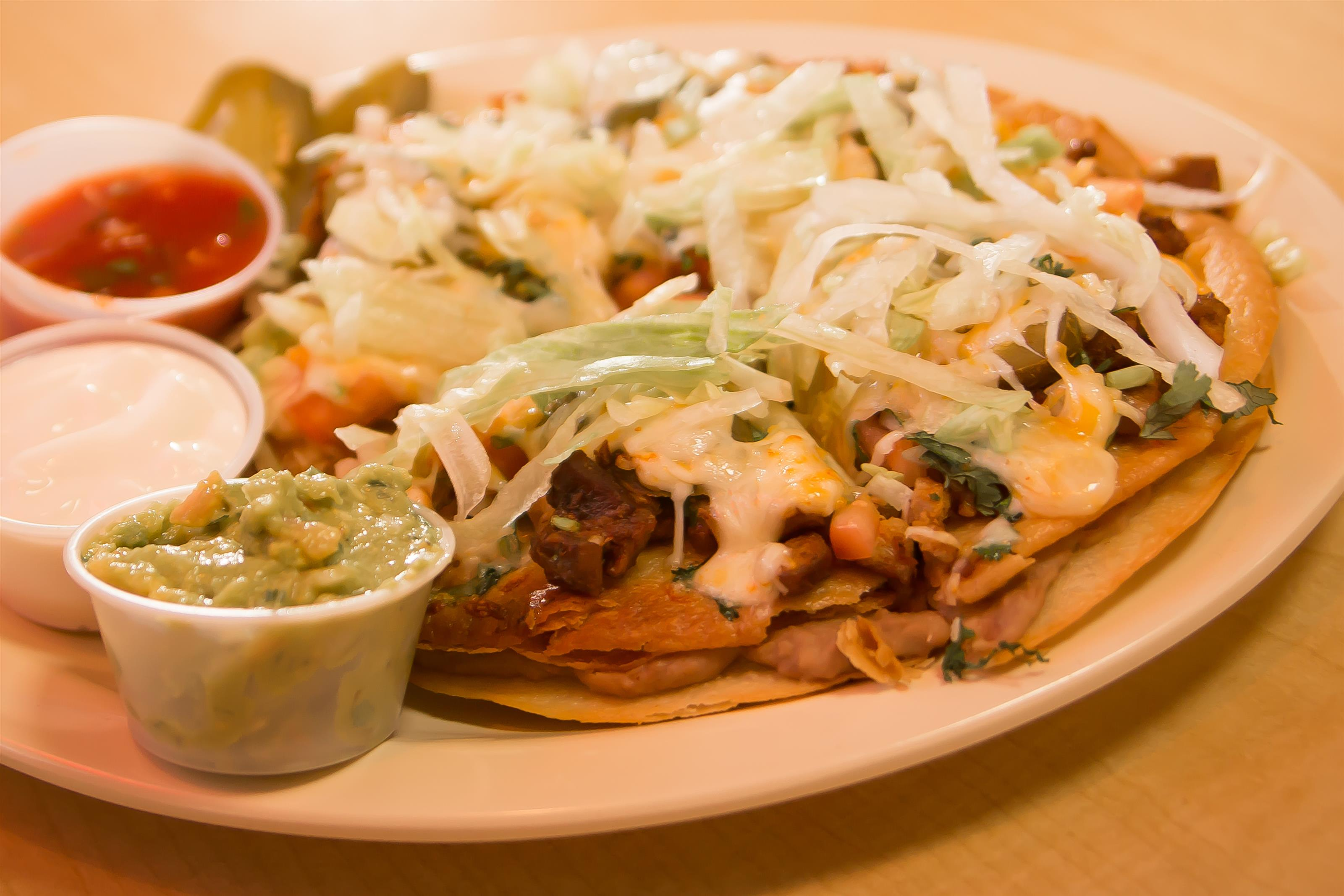 Chicken quesadilla topped with cheese, lettuce, jalapenos. Side of guacamole, salsa, ranch.