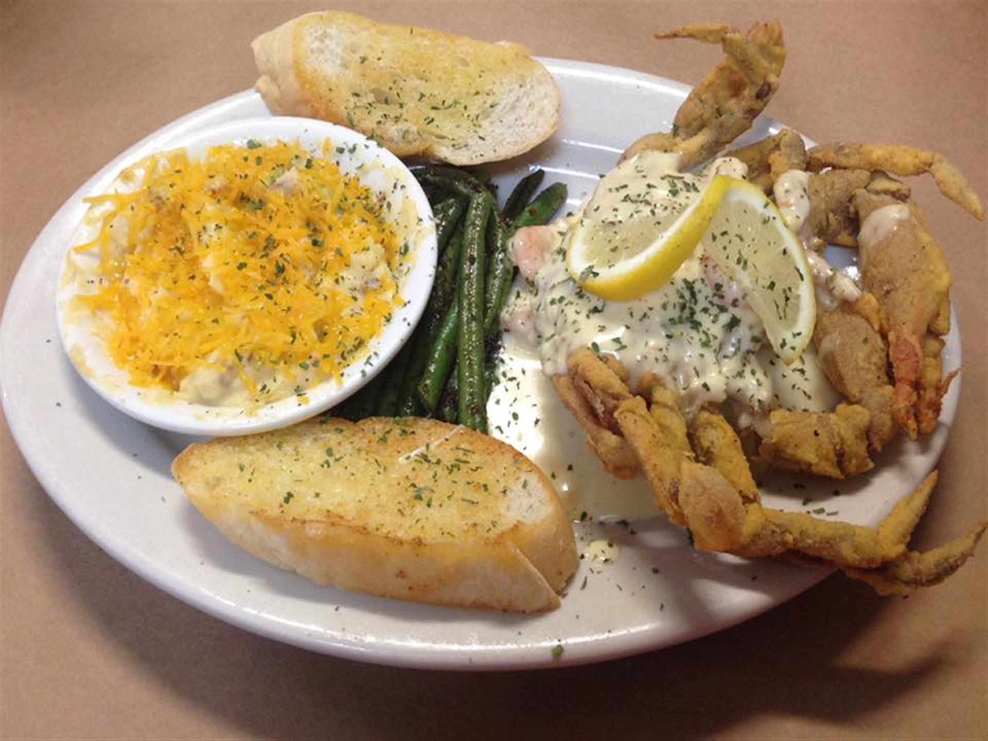 Seafood and soft shell crab with green beans and garlic toast