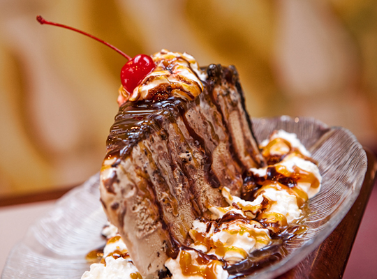 Panino's original Mound of Joy. Chocolate cake with a special chocolate pudding between layers iced with a delicate whipped cream icing