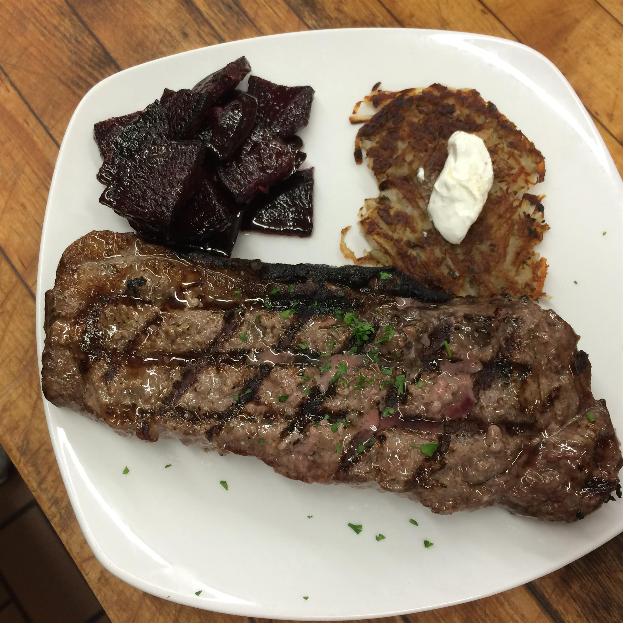 grilled steak with hashbrowns and beets