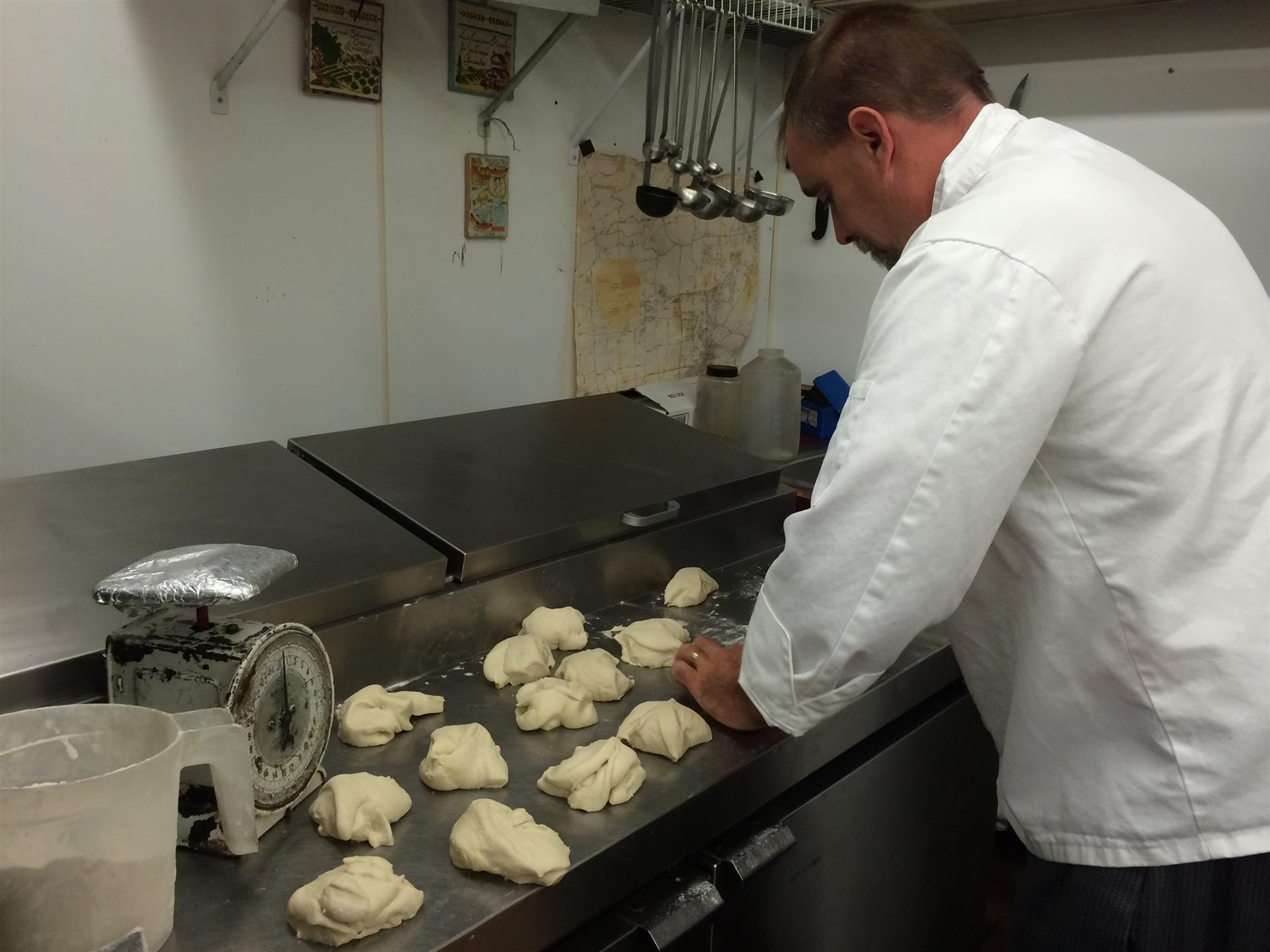 Chef Anthony Abeel rolling out pizza dough