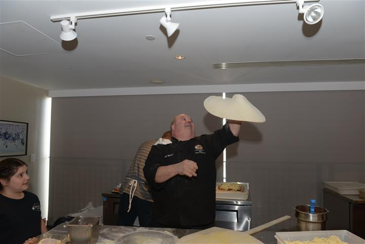 Chef throwing the pizza dough in the air