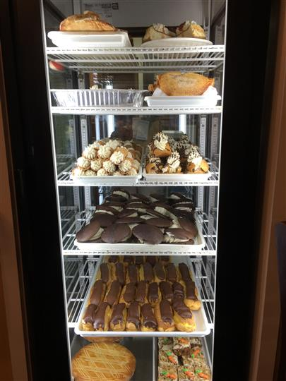 A fridge full of desserts