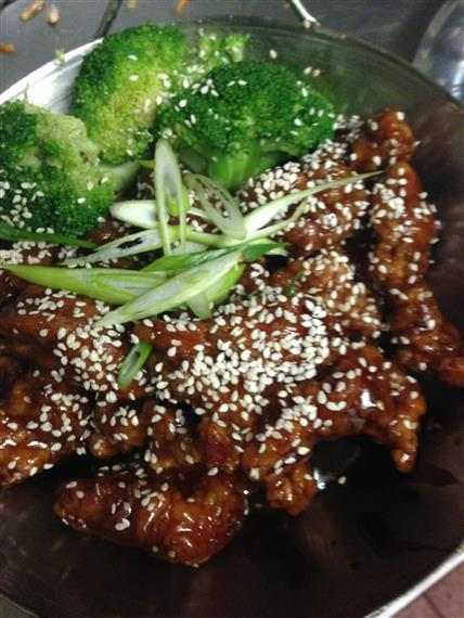 Sesame chicken and broccoli in bowl
