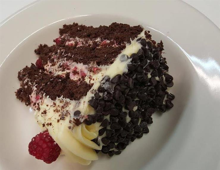 Raspberry and chocolate cake with cream and chocolate chips