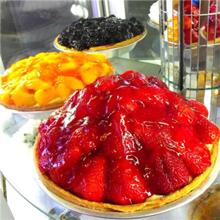 Seasonal fresh fruit pies on counter