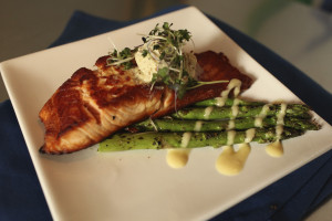 Salmon with asparagus on white dish