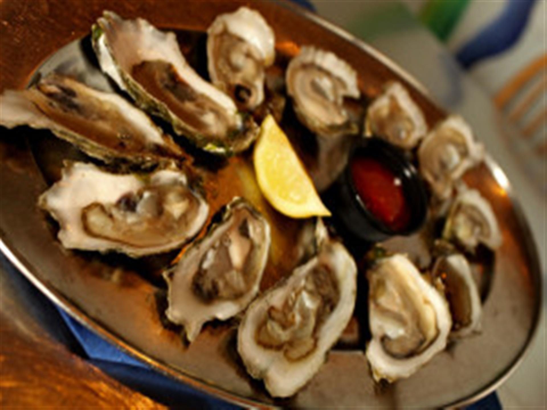 Oysters on the half shell with lemon