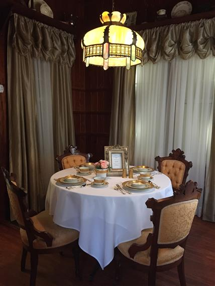 Dining room table for four with placesettings