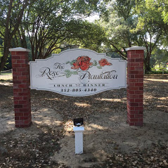 The Rose Plantation sign in between brick columns