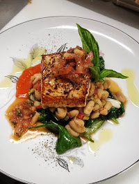 Salmon on top of chickpeas and spinach