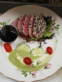 Tuna entree with tomatoes and cucumbers