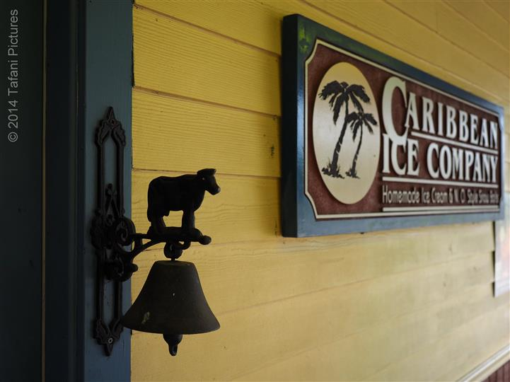 The wood sign of Caribbean ice Co next to the door bell