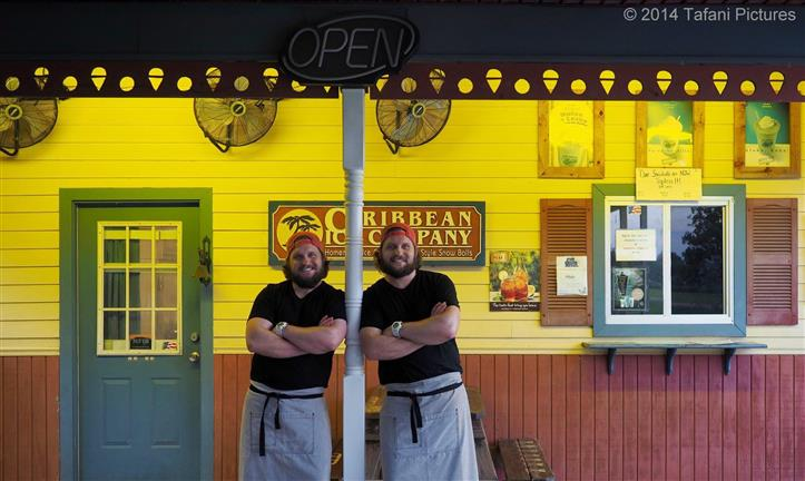 Two chefs smiling posing for night photo