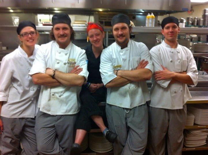 Five cooks posing for photo