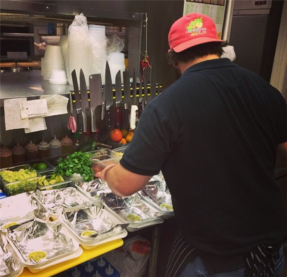 A chef working with catering boxes
