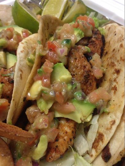 A double tortilla with grilled chicken, avocado and pico de gallo