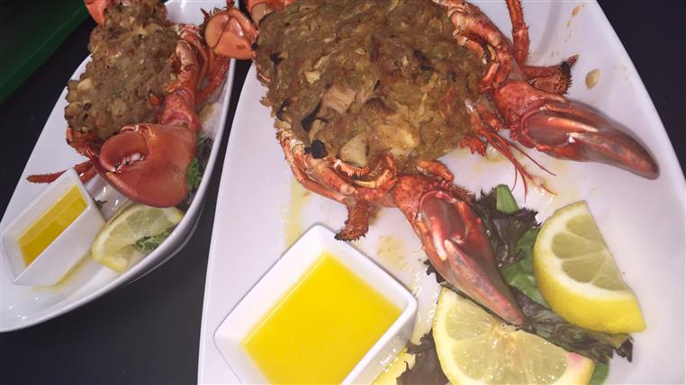 lobster with breaded inside with butter and lemon on the side