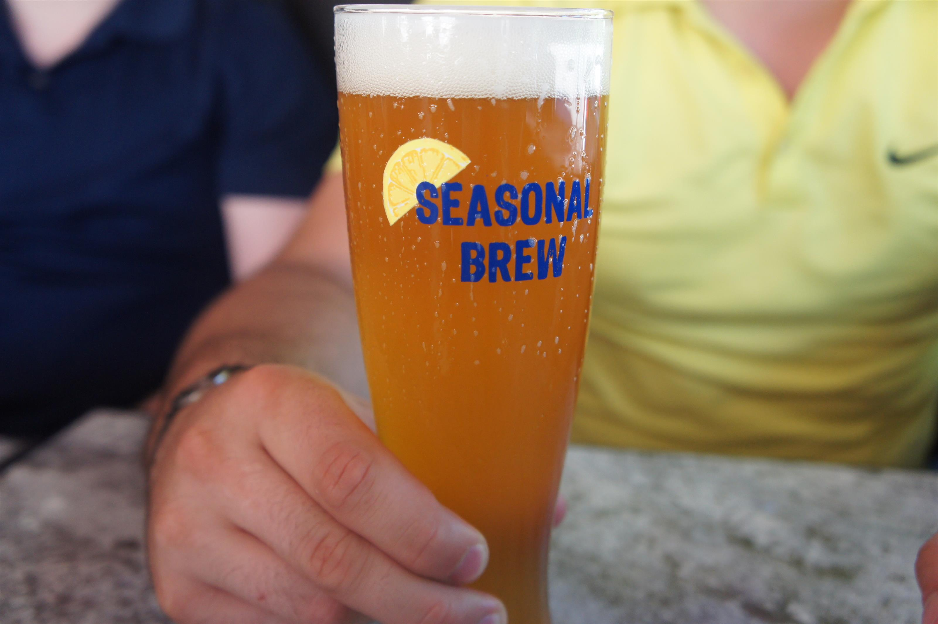 "Tall beer glass that writes ""Seasonal Brew"" on the side"