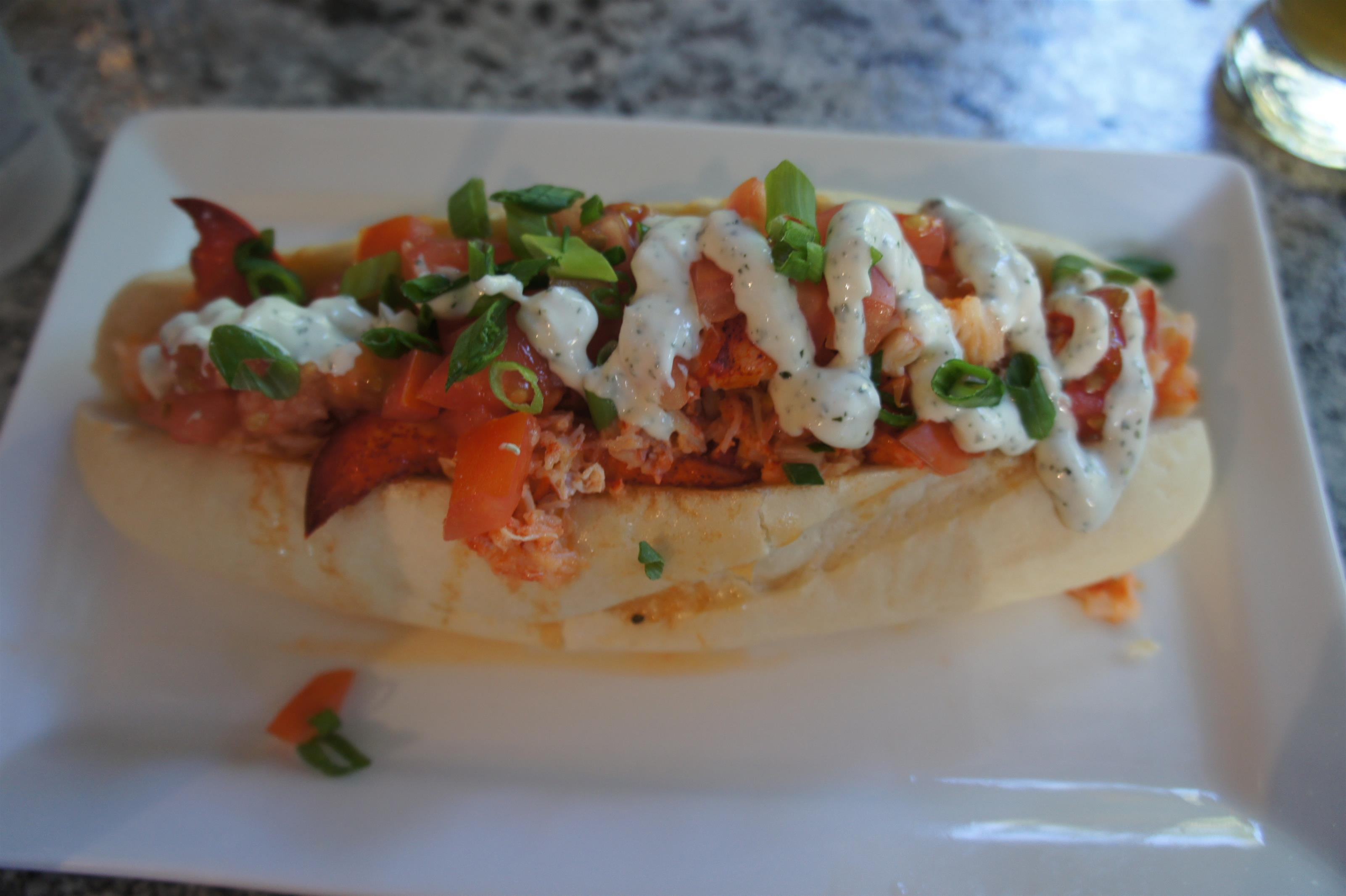 Shrimp and lobster meat tossed with green onion, tomato, bell peppers and dill mayonnaise on a hoagie roll.