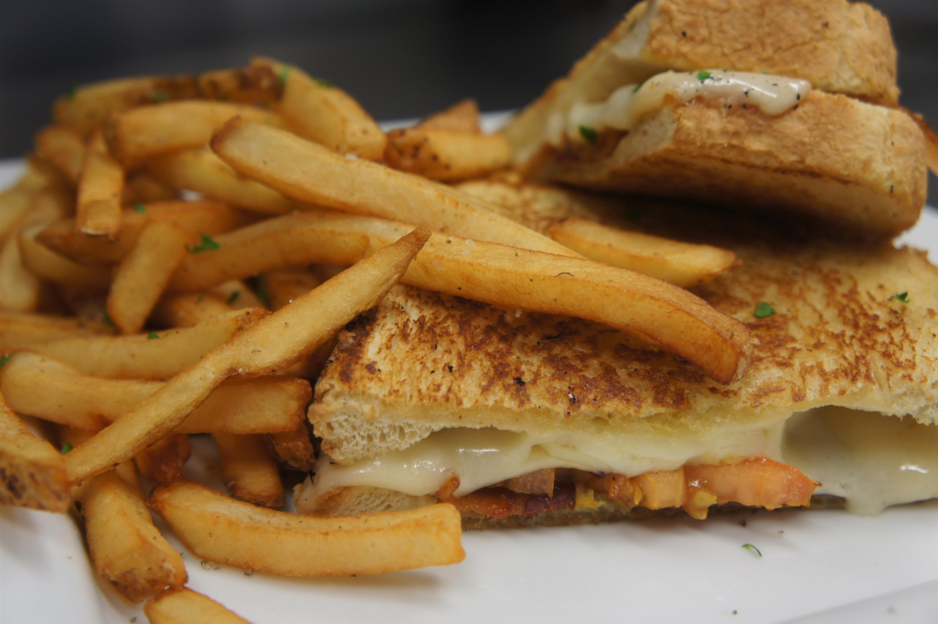 Grilled cheese with bacon served with fries