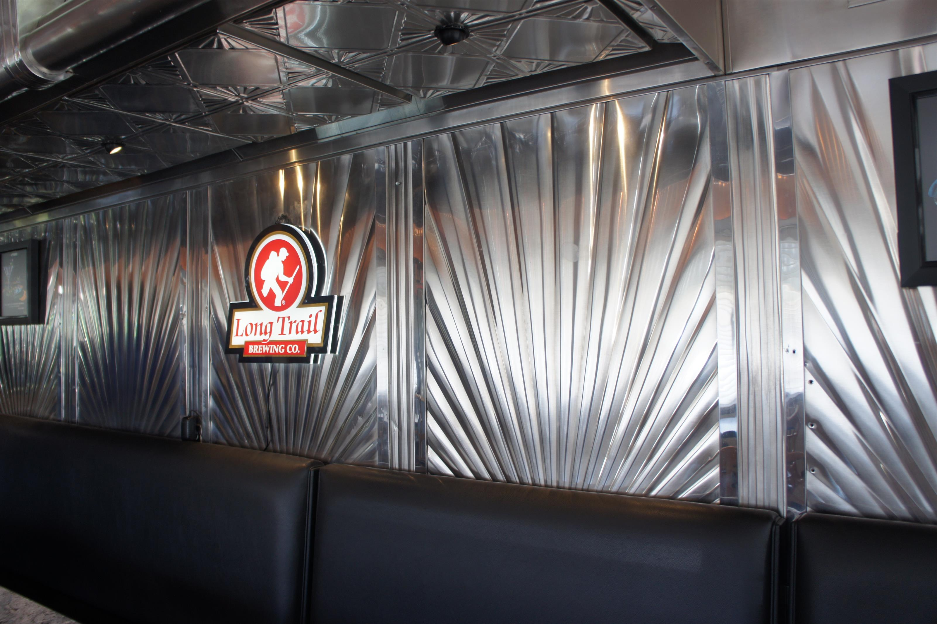 Decorative wall and sign over the booth seats