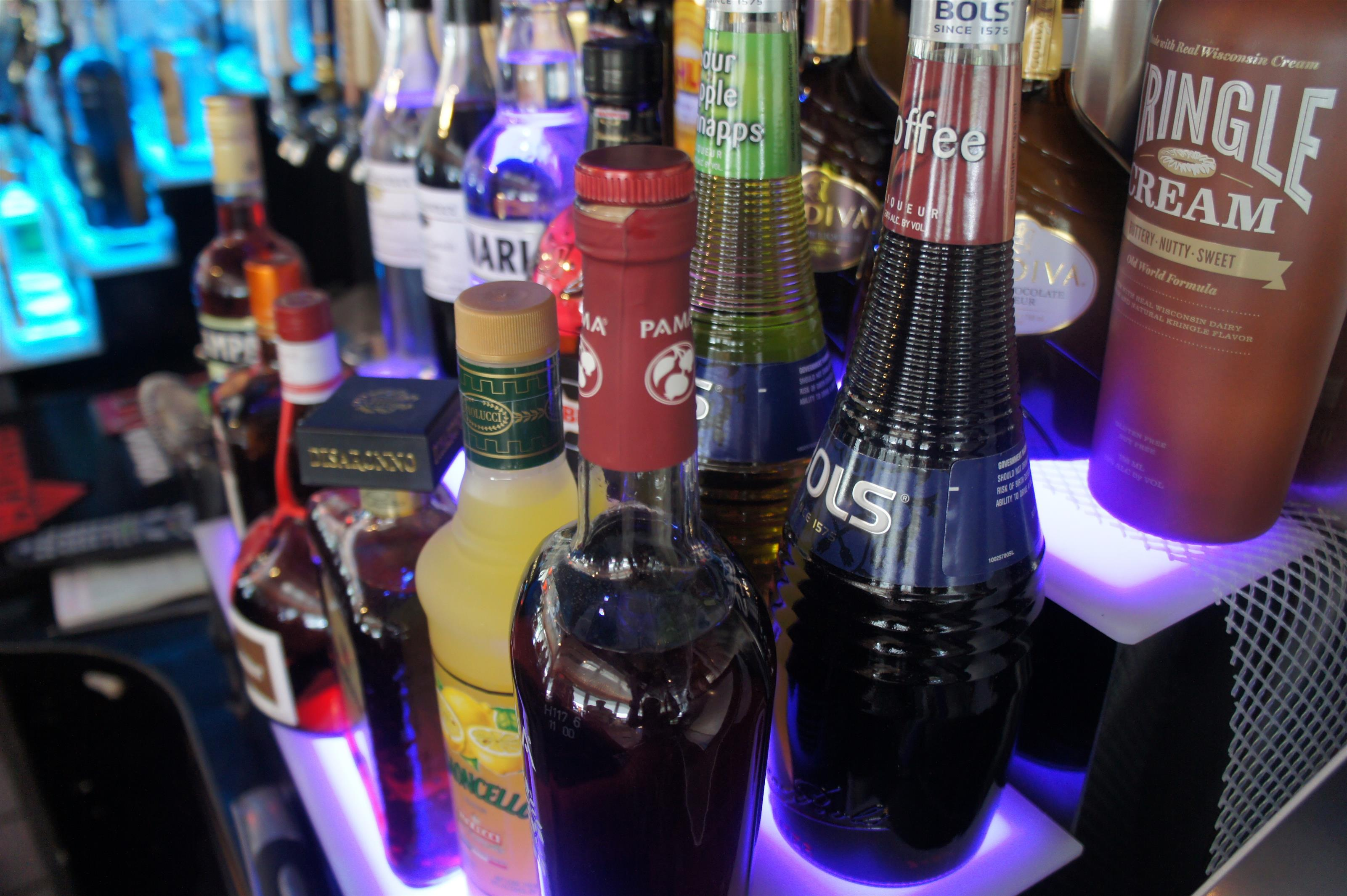 Colorful bottles of drinks in display at the bar