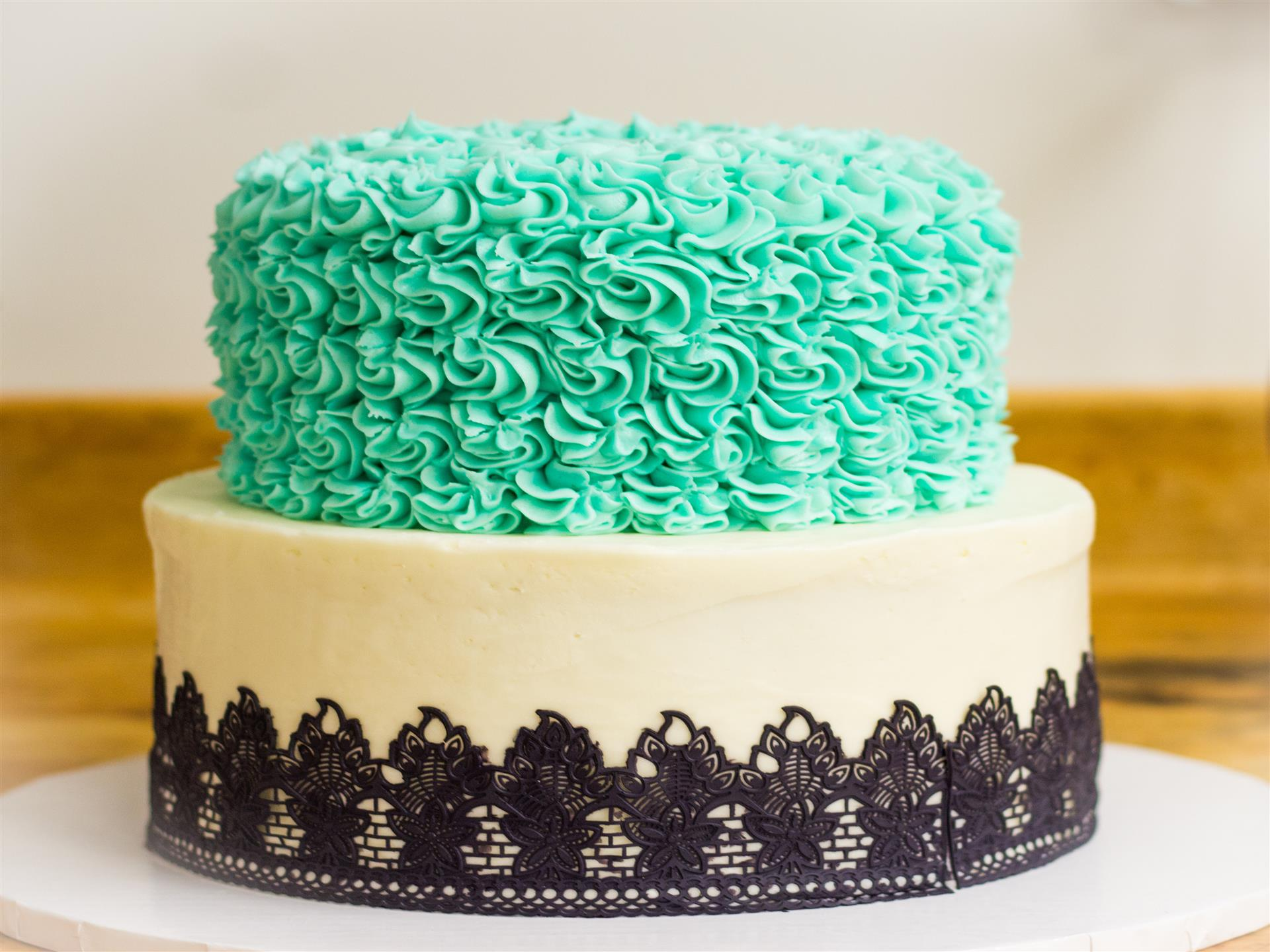 2 tier teal, black and white cake