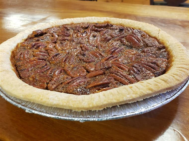 baked pecan pie in pie tin