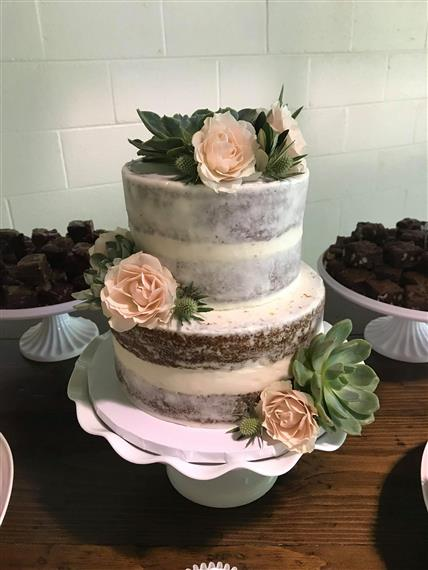 wedding cake with flowers and vanilla icing