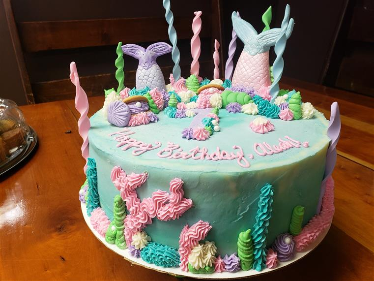 mermaid themed birthday cake with candles