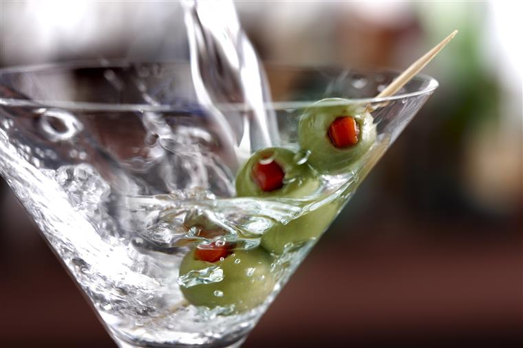 martini glass with 3 olives