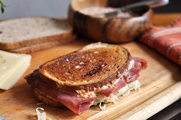 reuben sandwich on a cutting board