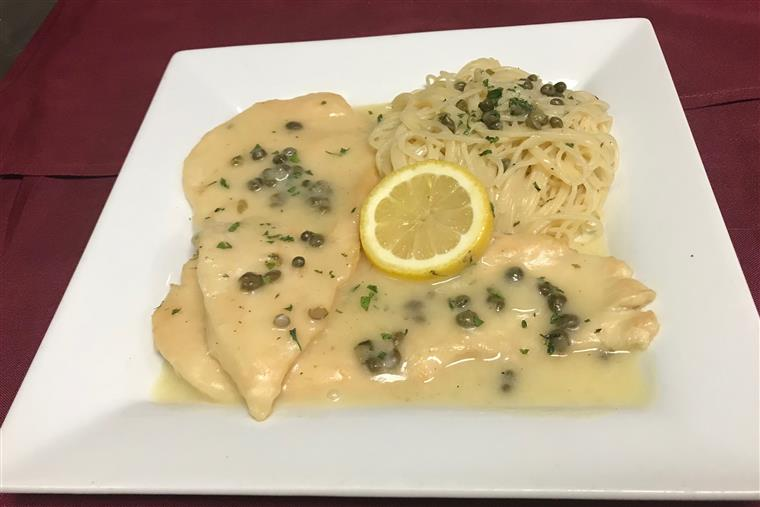 Chicken Piccata. Sauteed with capers, white wine and freshly prepared lemon sauce. Angel hair pasta on the side.