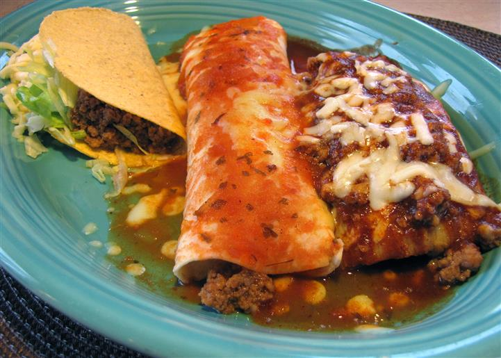 Combo plate with one taco, one enchilada and one chimichanga