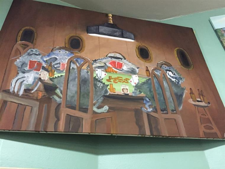 Painting caddy-cornered on wall showing crabs playing poker.