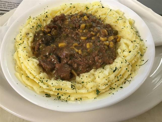 A dish of mashed potato bowl with a generous portion of our savory beef stew